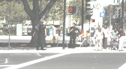 Cloud Strife cosplayer waiting for the crosswalk at FanimeCon 2006